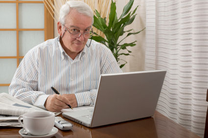 Senior man working from home with a laptop. Camera: Canon 5D